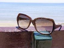Sunglasses and sea Stock Photos