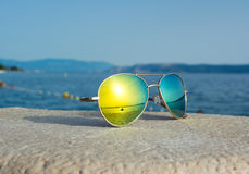 Sunglasses with sea reflection Royalty Free Stock Photos