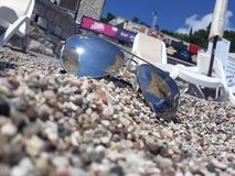 sunglasses, sea, summer, holiday, beach royalty free stock images