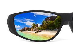 Sunglasses and seascape reflection Stock Photos