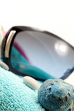 Sunglasses and seashell on a beach towel Royalty Free Stock Image