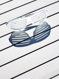 Sunglasses shadow sun Royalty Free Stock Images