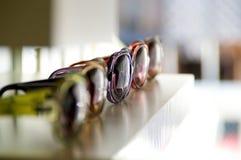 Sunglasses on a shelf Stock Image