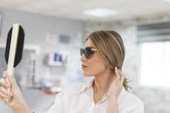 Sunglasses shopping royalty free stock photography
