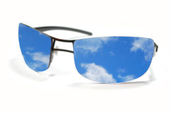Sunglasses and sky reflection Stock Images