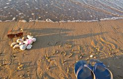 Sunglasses and slippers  shoes on the beach with stones Stock Photography