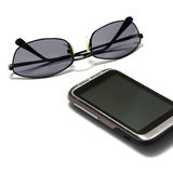 Sunglasses with smart phone Stock Image