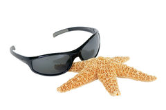 Sunglasses and starfish Stock Images