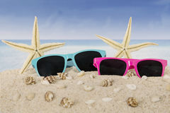 Sunglasses and starfish on beach Royalty Free Stock Photography
