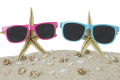 Sunglasses and starfish on beach sand Stock Photography