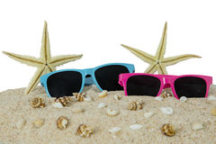 Sunglasses and starfishes on the sand Stock Images
