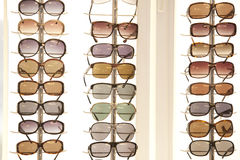 Sunglasses store. A many sunglasses in a shop Royalty Free Stock Photography