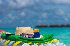 Sunglasses and straw hat on a air mattress in sea. Tropical summ Royalty Free Stock Image