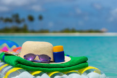 Sunglasses and straw hat on a air mattress in sea. Tropical summ Stock Photo