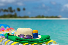 Sunglasses and straw hat on a air mattress in sea. Tropical summ Stock Images