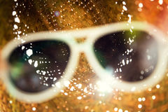 Sunglasses with straw hat Stock Photos