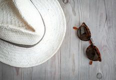 Sunglasses and straw hat Stock Images