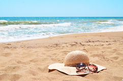 Sunglasses and straw hat Royalty Free Stock Photo