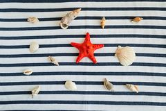 Summer, some sea stuff on white and stripped. Sunglasses, straw hat, seastar, stripped towel on white royalty free stock image