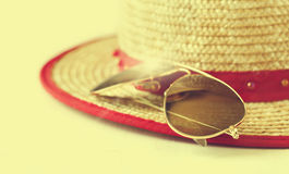 Sunglasses and Straw hat Royalty Free Stock Images
