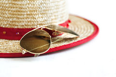 Sunglasses and Straw hat Stock Photos