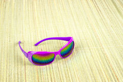 Sunglasses on straw mat Royalty Free Stock Photos