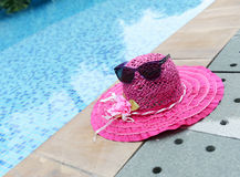 Sunglasses and summer hat Stock Photos