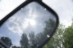 Sunglasses on in summer lens. Royalty Free Stock Images