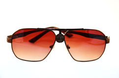 Sunglasses. Or sun glasses are a form of protective eyewear designed primarily to prevent bright sunlight and high-energy visible light from damaging or Stock Photo
