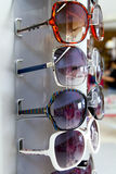 Sunglasses sun glasses stacked row in shop display Royalty Free Stock Photos