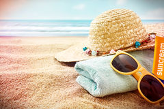Sunglasses and sunbathing items with vignette Stock Image