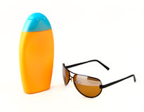 Sunglasses and sunscreen Royalty Free Stock Photography