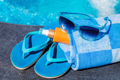 Sunglasses sunscreen cream,slippers and towel Stock Image