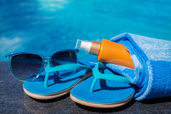 Sunglasses sunscreen cream,slippers and towel Stock Photography