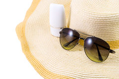 Sunglasses and sunscreen on Hat. Isolated on white background stock photography