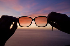 Sunglasses at sunset Royalty Free Stock Photos