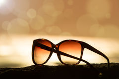 Sunglasses at Sunset and Defocused Horizon Stock Photography