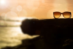 Sunglasses at Sunset and Defocused Horizon Royalty Free Stock Photography