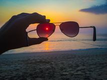 Sunglasses at sunset Royalty Free Stock Photography