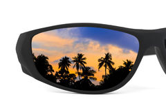 Sunglasses and sunset reflection Stock Photos