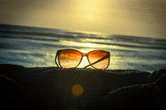 Sunglasses at Sunset - Vintage Filter Stock Images