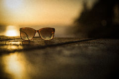 Sunglasses at Sunset - Vintage Grainy Filter Royalty Free Stock Photography