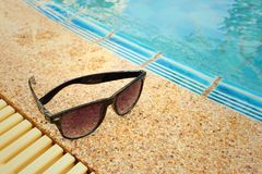 Sunglasses at the swimming pool of the hotel. Stock Photos