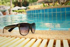 Sunglasses at the swimming pool of the hotel. Royalty Free Stock Photo