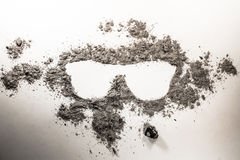 Sunglasses symbol silhouette drawing made in ash as uv sun burn stock image