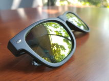 Sunglasses on the table. Stock Photography