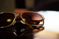 Sunglasses on the table Stock Photos