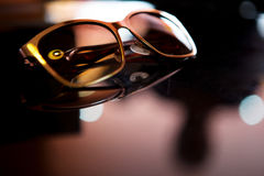 Sunglasses on the table Royalty Free Stock Image