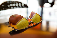 Sunglasses on the table Royalty Free Stock Photos