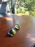 Sunglasses on the table. Royalty Free Stock Photography